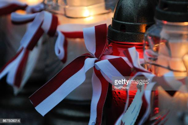 Portraits and candles are seen at a temporary shrine commemorating fallen scouts on the 100th birthday of the Bydgoszcz Scouts on October 28 2017
