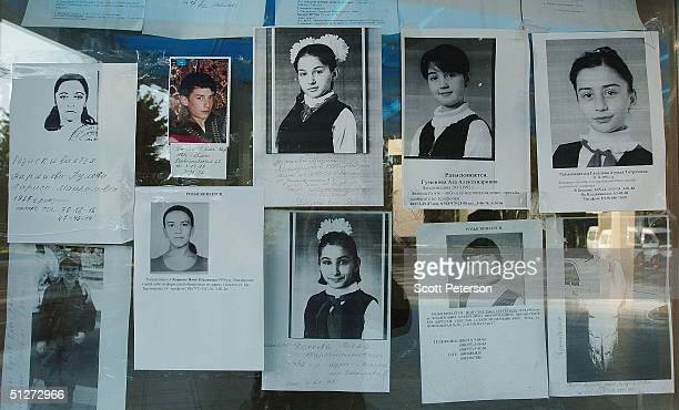 Portraits and lists of missing and dead children line the glass wall of the Palace of Culture September 8 2004 in Beslan southern Russia...