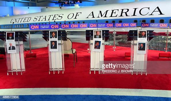 Portraits of candidates are placed on the podium in front Air Force One that flew President Reagan ahead of today's Republican Presidential Debate at...