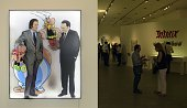 Portraits of creators of French comic 'Asterix le Gaulois' Albert Uderzo and Rene Goscinny are seen at the entrance of the exhibition 'Asterix en...