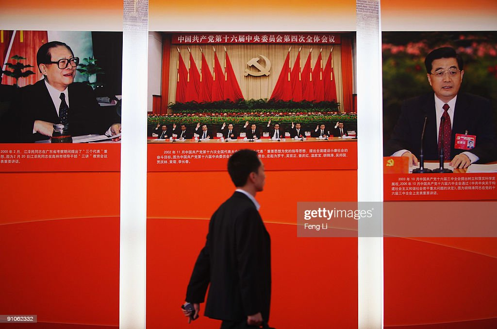Portraits of former Chinese leader <a gi-track='captionPersonalityLinkClicked' href=/galleries/search?phrase=Jiang+Zemin&family=editorial&specificpeople=159399 ng-click='$event.stopPropagation()'>Jiang Zemin</a> (L) and current President <a gi-track='captionPersonalityLinkClicked' href=/galleries/search?phrase=Hu+Jintao&family=editorial&specificpeople=203109 ng-click='$event.stopPropagation()'>Hu Jintao</a> (R) hang in the People's Republic Of China 60th Anniversary Exhibition at the Beijing Exhibition Center on September 23, 2009 in Beijing, China. The grand celebrations to commemorate the 60th anniversary of the founding of the People's Republic of China are set to include a military parade and mass pageant consisting of about 200,000 citizens in Tian'anmen Square on October 1.