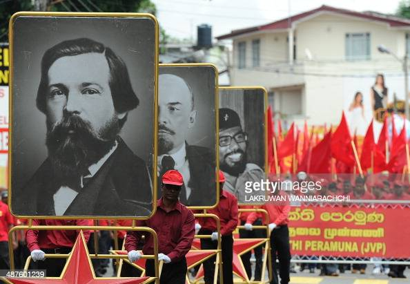 Portraits of German philosopher and social scientist Friedrich Engels Russian communist revolutionary Vladimir Lenin and Sri Lanka's Marxist JVP...