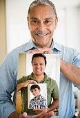 Portraits of Hispanic grandfather, father and son