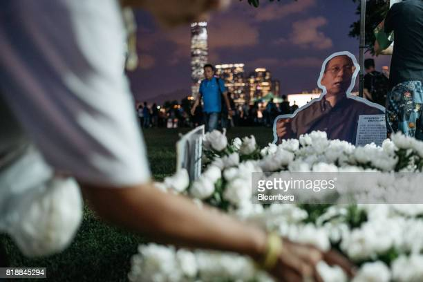 Portraits of Liu Xiaobo and floral tributes sit on display at a memorial vigil held for Chinese Nobel Peace Prizewinner Liu Xiaobo in Hong Kong China...