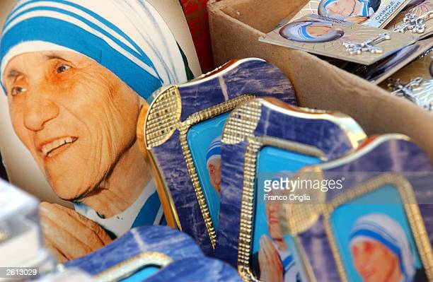 Portraits of Mother Teresa are shown on various souvenirs displayed in a religious shop in front of St Peter's Square October 18 2003 in Rome Italy...