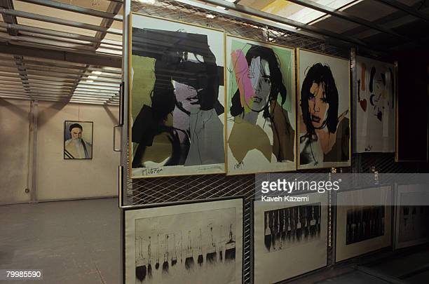 Portraits of rock star Mick Jagger by American pop artist Andy Warhol in the cellar of the Tehran Museum of Contemporary Art with a painting of...