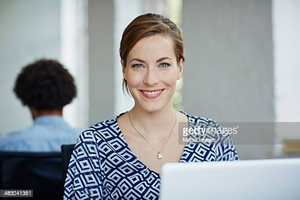 Portraits of smiling business woman