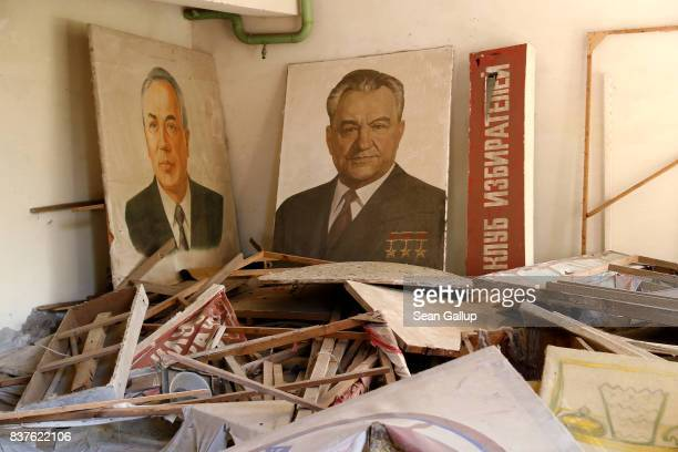 Portraits of Soviet Unionera leaders stand in a room of an abandoned cultural center in the ghost town of Pripyat not far from the Chernobyl nuclear...