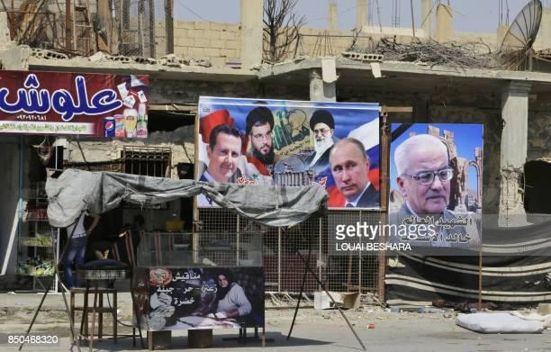 Portraits of Syrian President Bashar alAssad Lebanon's Hezbollah chief Hasan Nasrallah Iran's supreme leader Ayatollah Ali Khamenei Russian President...
