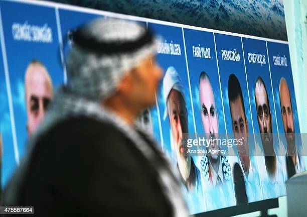 Portraits of the Mavi Marmara victims are seen in Amman Jordan on June 2 2015 during an event held by the Jordanian Engineers Association to mark the...