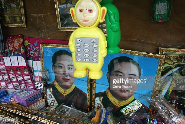 Portraits of the Panchen Lama are sold at a store on August 29 2006 in Nyingchi County of Tibet Autonomous Region China Chinese tourists are flooding...