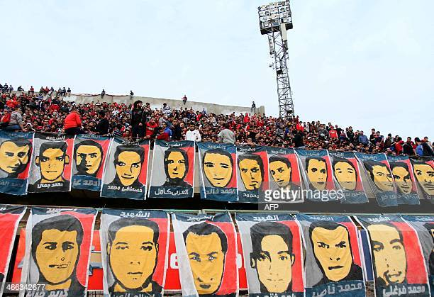 Portraits of the victims of the Port Said Stadium are seen as Supporters of Egypt's AlAhly football club gather in Mokhtar ElTetsh Stadium in Cairo...