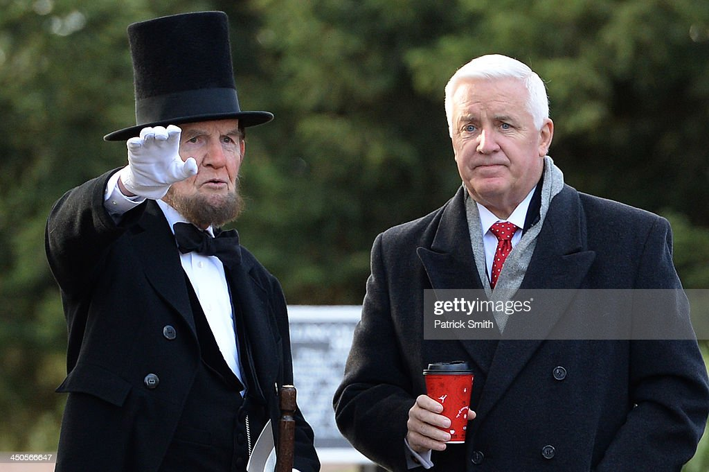 Portraying U.S. President Abraham Lincoln, James Getty (left), speaks to Pennsylvania Governor Tom Corbett during a commemoration of the 150th Anniversary of the Gettysburg Address at the Soldiers' National Cemetery at Gettysburg National Military Park on November 19, 2013 in Gettysburg, Pennsylvania. The iconic Gettysburg Address was given by U.S. President Abraham Lincoln in 1863 during the Civil War and highlighted the principles of democracy, human equality, and freedom and professed that 'government of the people, by the people, for the people, shall not perish from the earth.'.