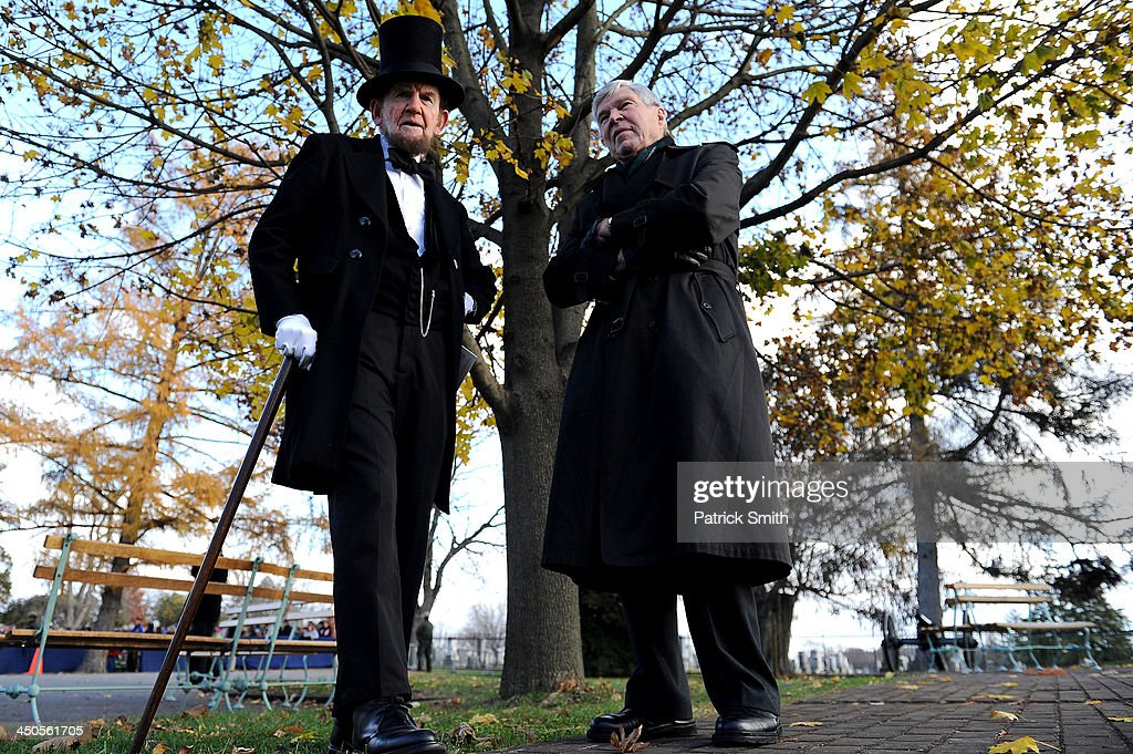 Portraying U.S. President Abraham Lincoln, James Getty (left) stands behind stage with keynote speaker and Pulitzer Prize author, James McPherson, before reciting the Gettysburg Address during a commemoration of the 150th Anniversary of the Gettysburg Address at the Soldiers' National Cemetery at Gettysburg National Military Park on November 19, 2013 in Gettysburg, Pennsylvania. The iconic Gettysburg Address speech was first given by U.S. President Abraham Lincoln in 1863 during the Civil War.