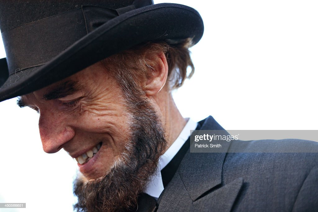 Portraying U.S. President Abraham Lincoln, Tom Scott, talks to visitors during a commemoration of the 150th Anniversary of the Gettysburg Address at the Soldiers' National Cemetery at Gettysburg National Military Park on November 19, 2013 in Gettysburg, Pennsylvania. The iconic Gettysburg Address was given by U.S. President Abraham Lincoln in 1863 during the Civil War and highlighted the principles of democracy, human equality, and freedom and professed that 'government of the people, by the people, for the people, shall not perish from the earth.'.