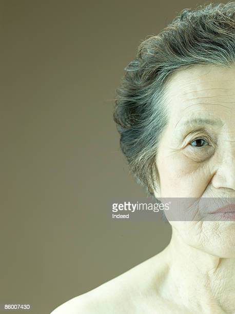 Portriat of senior woman, staring at camera