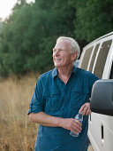 Portrit of smiling man next to a van