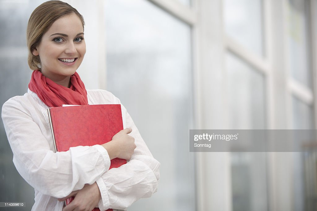 portrit of young woman holding files