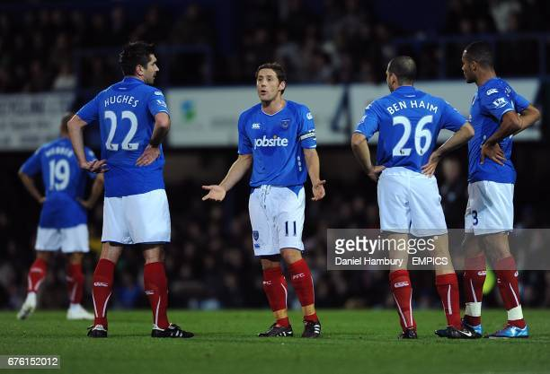 Portsmouth captain Michael Brown complains to his team mates after they went 21 down Richard Hughes Michael Brown Tal BenHaim and Younes Kaboul