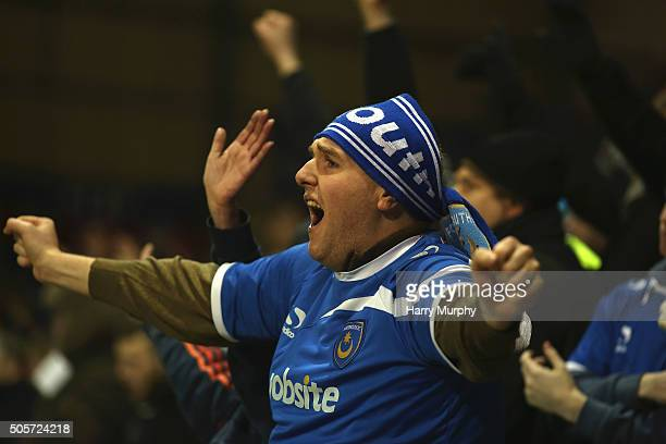 Portsmouth fan celebrates a goal during the Emirates FA Cup Third Round replay between Portsmouth and Ipswich Town at Fratton Park on January 19 2016...