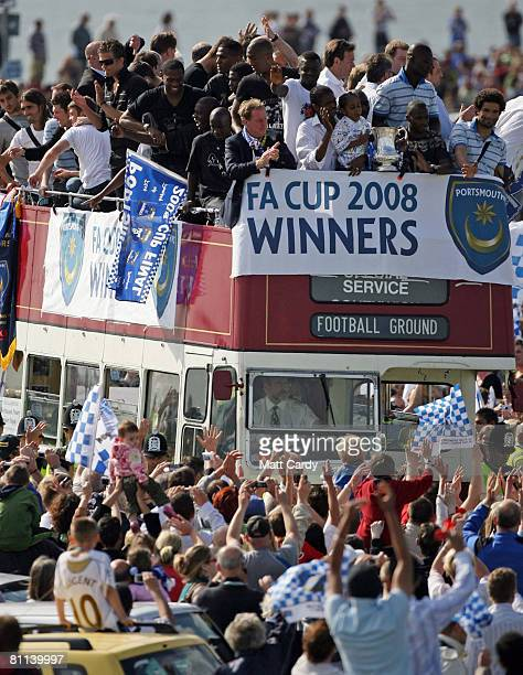Portsmouth fans celebrate as their team arrive in a open top bus as part of their victory parade at Southsea Common following their win in the FA Cup...