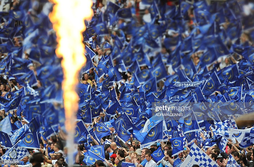Portsmouth fans cheer for their team against Chelsea during the FA Cup Final football match at Wembley, in north London, on May 15, 2010. AFP PHOTO/ADRIAN DENNIS FOR EDITORIAL USE Additional licence required for any commercial/promotional use or use on TV or internet (except identical online version of newspaper) of Premier League/Football League photos. Tel DataCo +44 207 2981656. Do not alter/modify photo