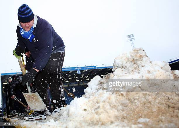Portsmouth fans clear snow from Fratton Park stadium before the weekend match against Birmingham City anyone that helps gets two free tickets for the...