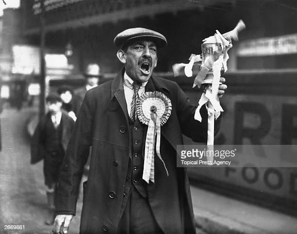Portsmouth Football Club supporter wearing a rosette and holding a model FA Cup arrives in London for the FA Cup final against Bolton Wanderers at...