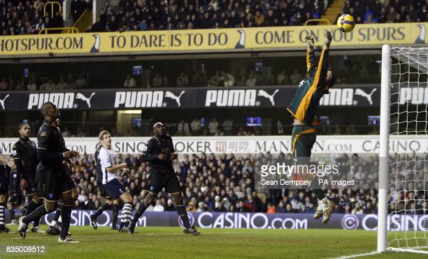 Portsmouth goalkeeper David James makes a save late in the game