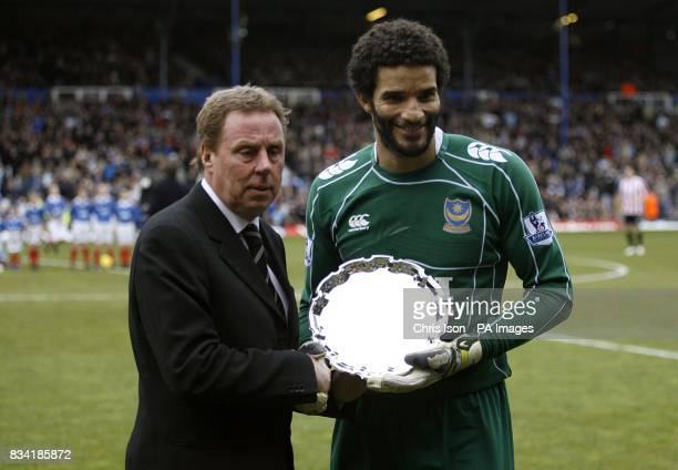 Portsmouth goalkeeper David James receives an award for 500 Premier League appearances from manager Harry Redknapp