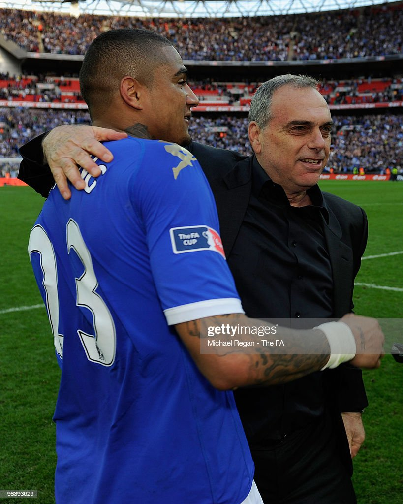 Portsmouth manager <a gi-track='captionPersonalityLinkClicked' href=/galleries/search?phrase=Avram+Grant&family=editorial&specificpeople=4506029 ng-click='$event.stopPropagation()'>Avram Grant</a> celebrates winning the game with <a gi-track='captionPersonalityLinkClicked' href=/galleries/search?phrase=Kevin-Prince+Boateng&family=editorial&specificpeople=613049 ng-click='$event.stopPropagation()'>Kevin-Prince Boateng</a> of Portsmouth during the FA Cup sponsored by E.ON Semi Final match between Tottenham Hotspur and Portsmouth at Wembley Stadium on April 11, 2010 in London, England.