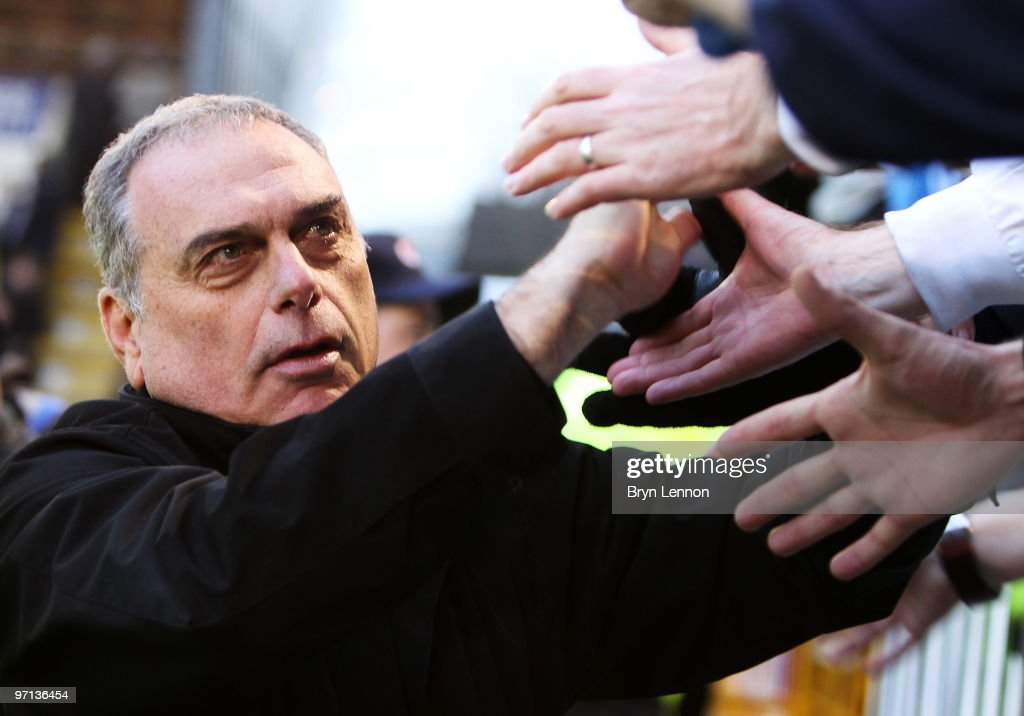 Portsmouth Manager <a gi-track='captionPersonalityLinkClicked' href=/galleries/search?phrase=Avram+Grant&family=editorial&specificpeople=4506029 ng-click='$event.stopPropagation()'>Avram Grant</a> greets fans after the Barclays Premier League match between Burnley and Portsmouth at Turf Moor on February 27, 2010 in Burnley, England.