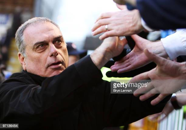 Portsmouth Manager Avram Grant greets fans after the Barclays Premier League match between Burnley and Portsmouth at Turf Moor on February 27 2010 in...