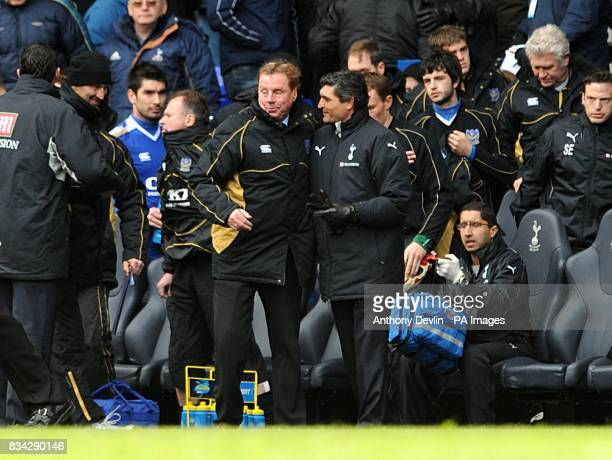 Portsmouth manager Harry Redknapp is consoled by TOttenham Hotspur manager Juande Ramos after the final whistle