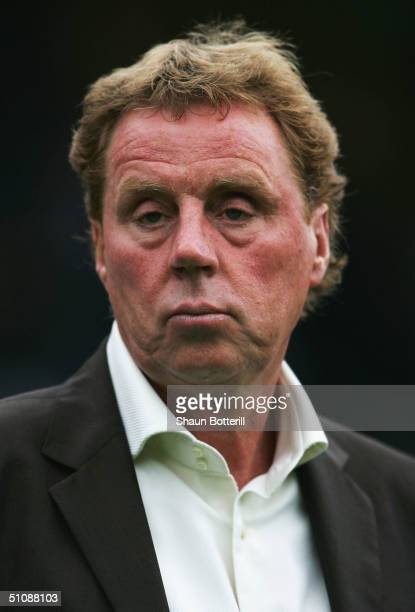Portsmouth manager Harry Redknapp looks on before the Pre Season Friendly match between Wycombe Wanderers and Portsmouth at the Causeway Stadium on...