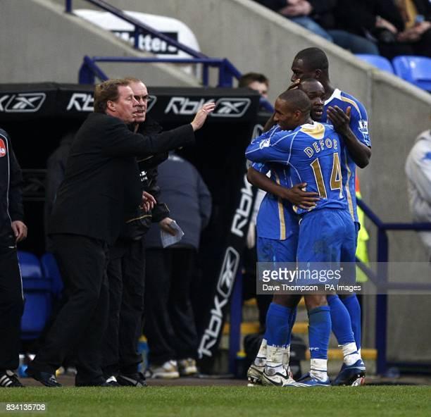 Portsmouth manager Harry Redknapp on the touchline as Lassana Diarra celebrates scoring with teammates