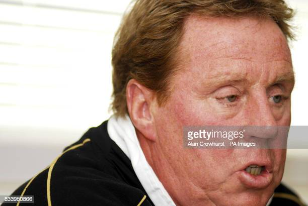 Portsmouth manager Harry Redknapp reads a statement during a news conference at the clubs training ground in Eastleigh Hampshire