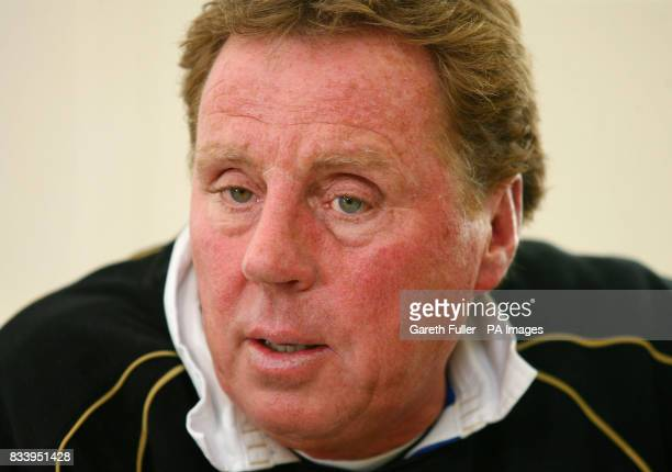 Portsmouth manager Harry Redknapp reads a statement during a news conference at the club's training ground in Eastleigh Hampshire