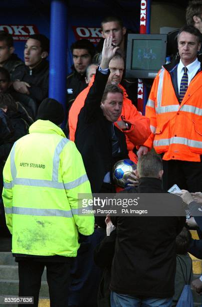 Portsmouth manager Harry Redknapp salutes the fans before the game