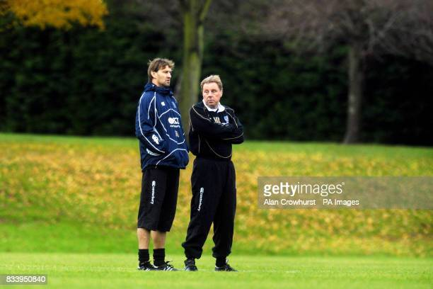 Portsmouth manager Harry Redknapp stands with assistant manager Tony Adams at a training session this morning in Eastleigh