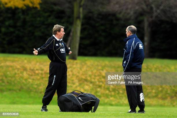 Portsmouth manager Harry Redknapp talks to first team coach Joe Jordan at a training session this morning in Eastleigh