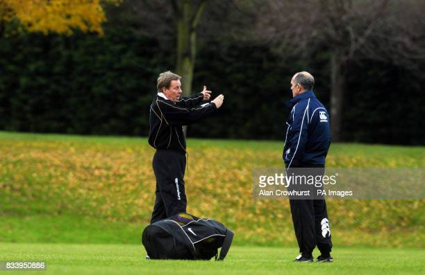 Portsmouth manager Harry Redknapp talks with first team coach Joe Jordan at a training session this morning in Eastleigh