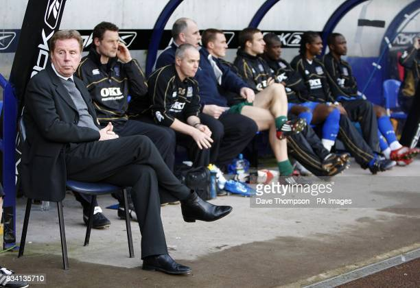 Portsmouth manager Harry Redknapp with the rest of the bench prior to kick off