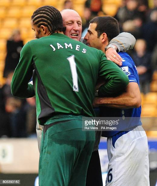 Portsmouth manager Paul Hart celebrates their victory with Portsmouth's David James and Tal BenHaim after the final whistle