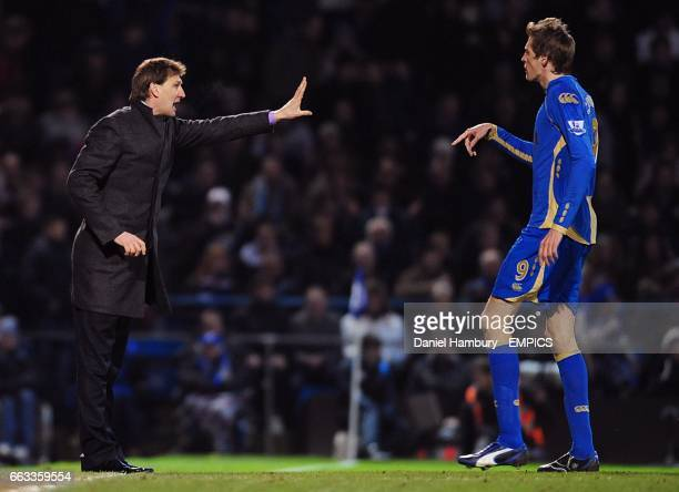 Portsmouth manager Tony Adams instructs his player Peter Crouch from the touchline