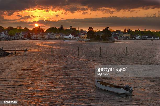 Portsmouth New Hampshire at sunset with the Piscataqua River in the foreground United States