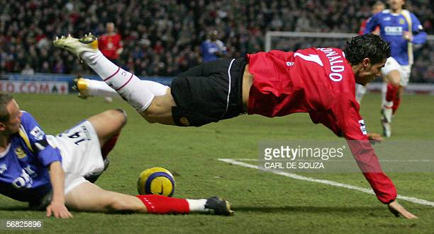 Manchester United's Cristiano Ronaldo is tackled by Portsmouth's Miatthew Taylor during their premiership match in Portsmouth 11 February 2006 AFP...