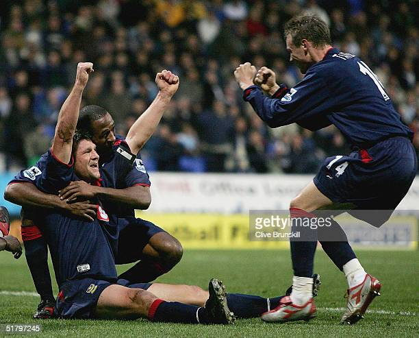 Portsmouth's Arjan De Zeeuw celebrates after scoring the first goal during the Barclays Premiership match between Bolton Wanderers and Portsmouth at...