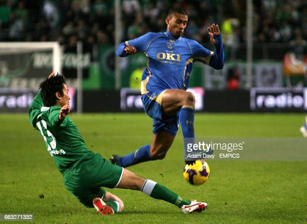 Portsmouth's Armand Traore is tackled by Wolfsburg's Makoto Hasebe