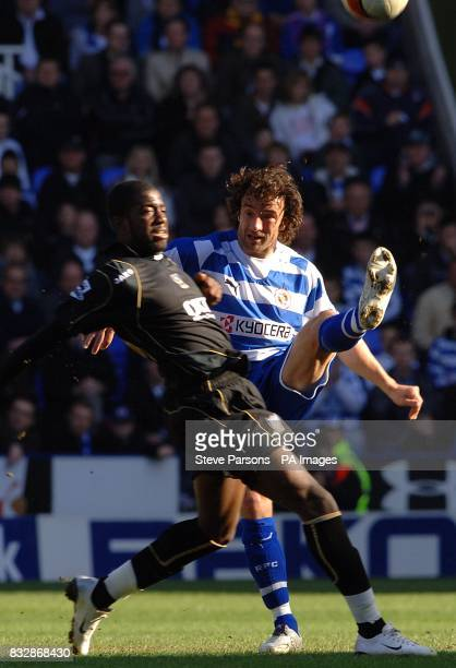 Portsmouth's Arnold Mvuembah and Reading's Stephen Hunt in action